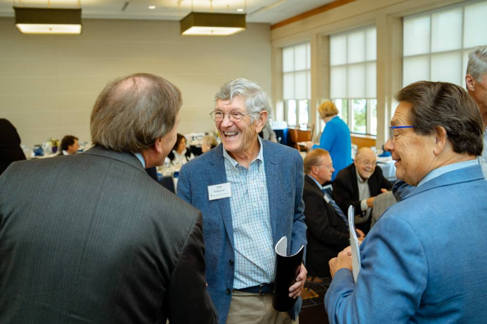 Jim Brooks talking with guests at the Foundation Annual Meeting